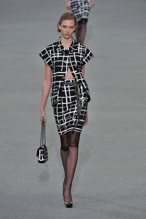 Dress, Sleeve, Shoulder, Joint, Standing, Human leg, Pattern, One-piece garment, Style, Street fashion,