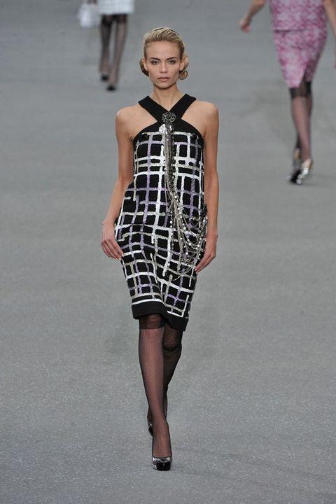 Clothing, Shoulder, Human leg, Dress, Joint, Waist, One-piece garment, Style, Fashion show, Fashion model,