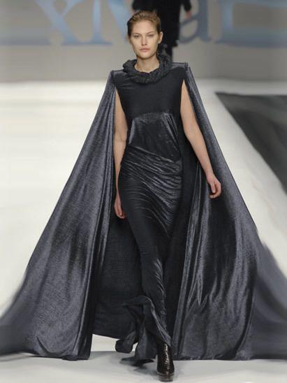 Hairstyle, Shoulder, Fashion show, Dress, Joint, Fashion model, Runway, Style, Formal wear, Fashion,