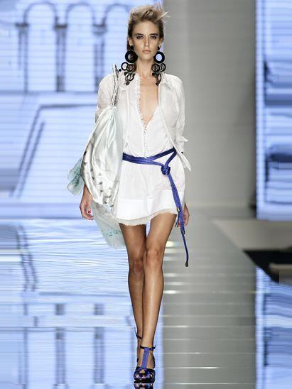 Shoulder, Fashion show, Fashion accessory, Style, Fashion model, Jewellery, Runway, Dress, High heels, Fashion,
