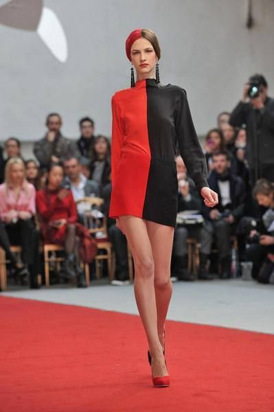 Lip, Fashion show, Event, Shoulder, Runway, Red, Joint, Human leg, Outerwear, Fashion model,