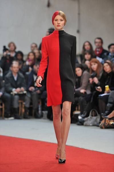 Lip, Fashion show, Event, Shoulder, Runway, Red, Joint, Outerwear, Flooring, Fashion model,