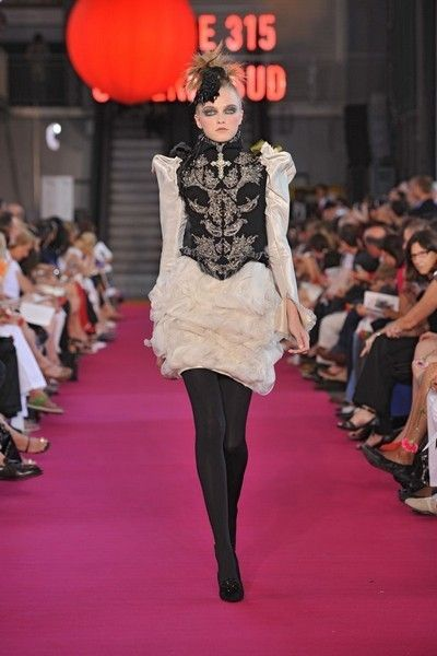 Clothing, Footwear, Fashion show, Event, Shoulder, Runway, Lantern, Joint, Red, Outerwear,