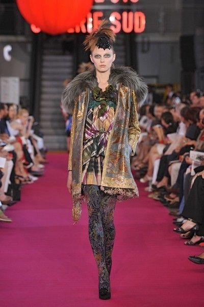Fashion show, Runway, Outerwear, Red, Flooring, Style, Lantern, Fashion model, Carpet, Fashion,