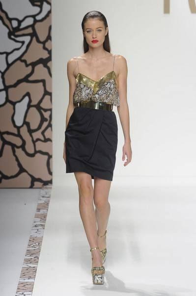 Brown, Skin, Shoulder, Human leg, Fashion show, Joint, Waist, Fashion model, Style, Runway,