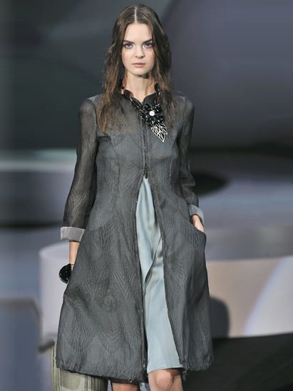 Sleeve, Shoulder, Joint, Fashion show, Outerwear, Dress, Fashion model, Style, Formal wear, Fashion,