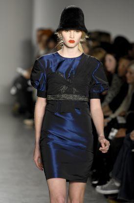 Shoulder, Dress, Joint, Fashion show, Style, Waist, Fashion model, Hat, One-piece garment, Runway,