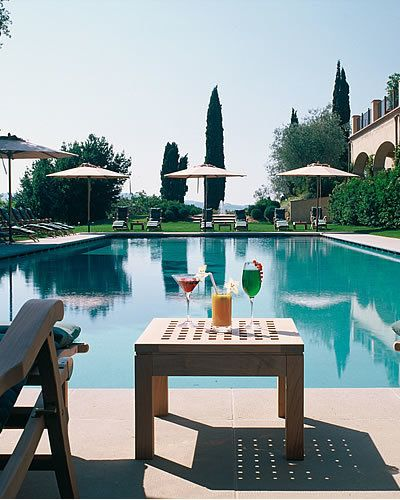 Swimming pool, Water, Furniture, Table, Resort, Outdoor furniture, Outdoor table, Resort town, Reflection, Water feature,