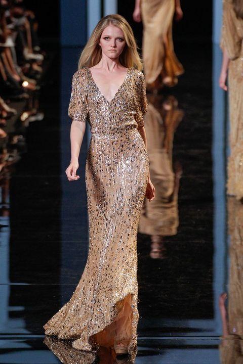 Fashion show, Shoulder, Fashion model, Waist, Runway, Dress, Style, Fashion, Neck, Model,
