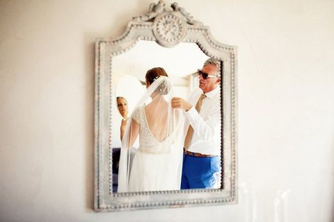 Photograph, Mirror, Bridal clothing, Bride, Embellishment, Wedding dress, Love, Gesture, Gown, Bridal accessory,