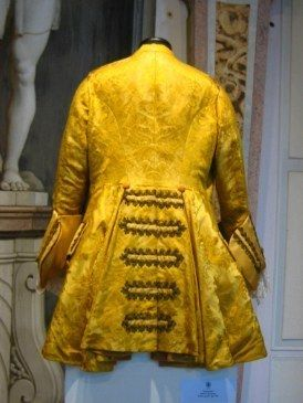 Yellow, Sleeve, Textile, Amber, Sculpture, Door, Pattern, Natural material, Statue, Fashion design,