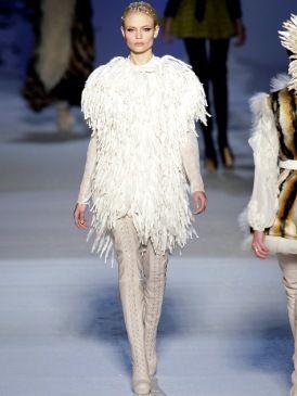 Clothing, Leg, Fashion show, Shoulder, Textile, Joint, Winter, Outerwear, Runway, Fashion model,