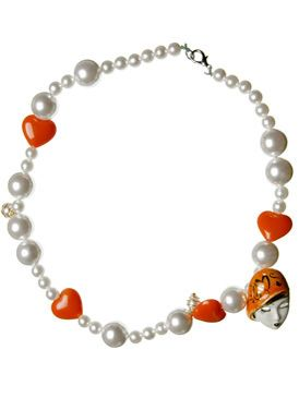 Brown, Jewellery, Photograph, Red, White, Fashion accessory, Natural material, Amber, Orange, Art,