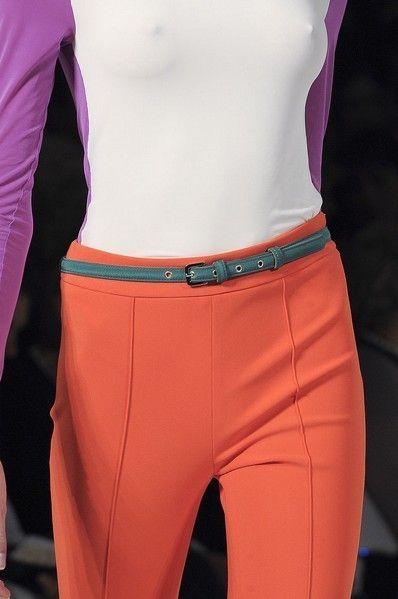 Shoulder, Textile, Waist, Joint, Sportswear, Active pants, Purple, Orange, Trunk, Abdomen,