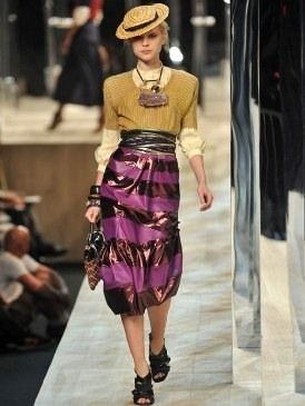 Clothing, Sleeve, Shoulder, Hat, Textile, Joint, Fashion show, Style, Formal wear, Waist,