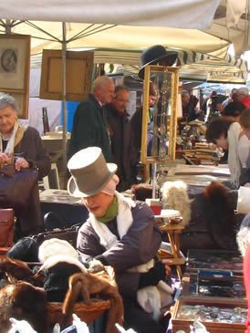 Hat, Human body, Community, Public space, Headgear, Temple, Sun hat, Market, Customer, Marketplace,