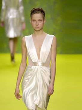 Clothing, Yellow, Green, Shoulder, Dress, Joint, Fashion show, Formal wear, Style, One-piece garment,