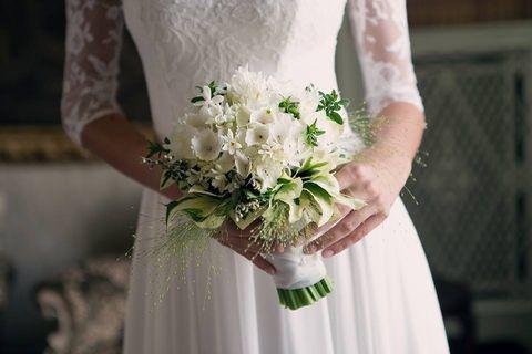 Finger, Petal, Bouquet, Bridal clothing, Textile, Wedding dress, Photograph, Joint, Dress, Flower,