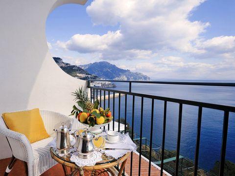Table, Furniture, Chair, Horizon, Outdoor furniture, Home, Balcony, Ocean, Outdoor table, Linens,