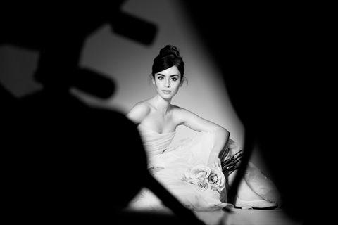 Elbow, Flash photography, Monochrome, Model, Bridal clothing, Monochrome photography, Headpiece, Bun, Wedding dress, Bridal accessory,