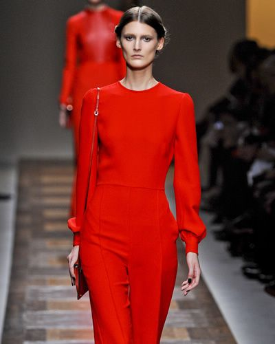Lip, Fashion show, Sleeve, Shoulder, Red, Joint, Runway, Fashion model, Waist, Style,