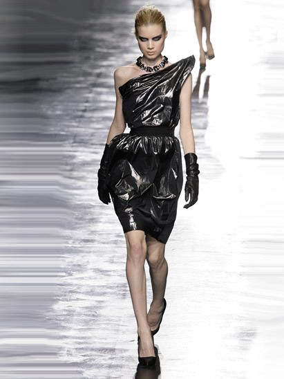 Human, Fashion show, Human body, Shoulder, Dress, Joint, Human leg, Runway, Fashion model, Style,