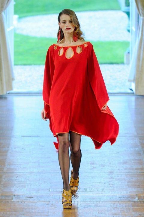 Shoulder, Fashion show, Red, Dress, Style, Runway, Fashion model, Floor, Flooring, One-piece garment,