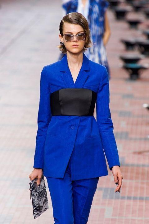Clothing, Eyewear, Blue, Sleeve, Sunglasses, Outerwear, Electric blue, Coat, Style, Street fashion,