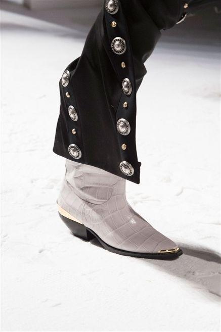 Costume accessory, Tan, Beige, Natural material, Leather, Fashion design, Boot, Embellishment,
