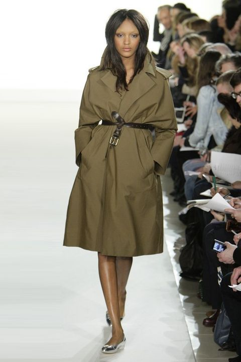 Clothing, Footwear, Brown, Sleeve, Human body, Shoulder, Shoe, Fashion show, Joint, Outerwear,