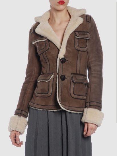 Clothing, Brown, Sleeve, Shoulder, Coat, Collar, Textile, Jacket, Joint, Standing,