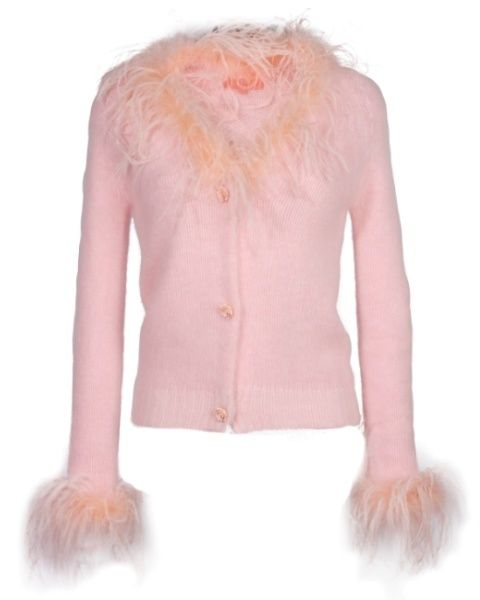 Skin, Sleeve, Shoulder, Textile, Joint, Fur clothing, Orange, Natural material, Peach, Fashion,