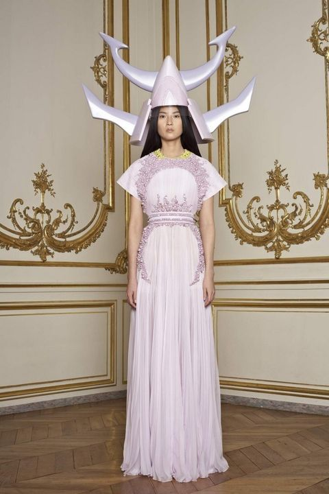Clothing, Dress, Formal wear, Headgear, Gown, Costume accessory, Metal, Lavender, Costume, Costume design,