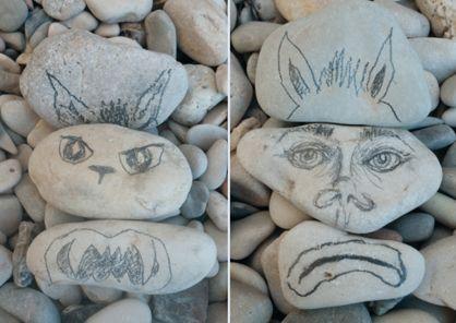 Rock, Artifact, Art, Sculpture, Creative arts, Carving, Natural material, Craft, Pebble, Stone carving,