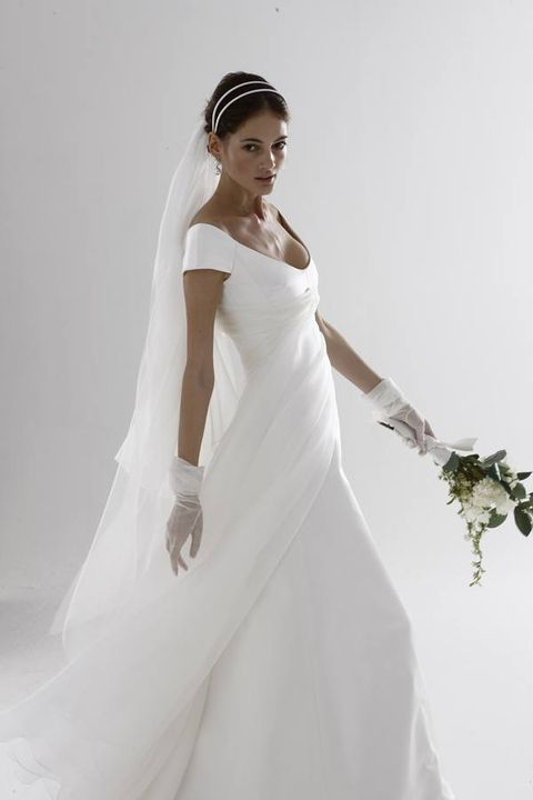 Dress, Sleeve, Shoulder, Bridal clothing, Textile, Elbow, Photograph, Joint, Bridal accessory, White,