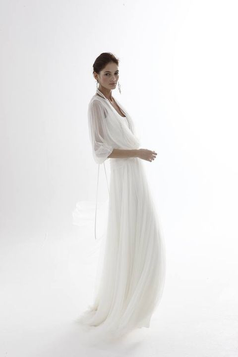 Hairstyle, Sleeve, Human body, Shoulder, Standing, Joint, Elbow, Gown, Style, Formal wear,