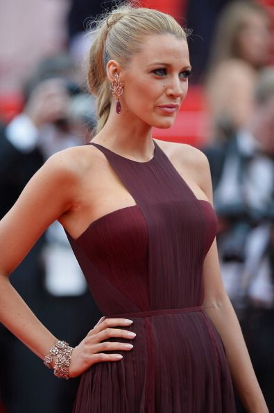 Clothing, Hair, Head, Ear, Nose, Hairstyle, Dress, Shoulder, Red, Style,