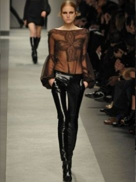 Clothing, Footwear, Leg, Brown, Fashion show, Human body, Shoulder, Textile, Joint, Outerwear,