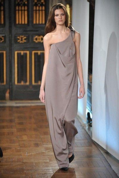 Shoulder, Dress, Joint, Floor, Flooring, Formal wear, One-piece garment, Style, Fashion model, Wood flooring,