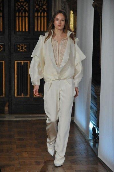 Fashion model, Beige, Wood flooring, Fashion design, Haute couture, Costume design, Model, Laminate flooring, Silk, Fashion show,