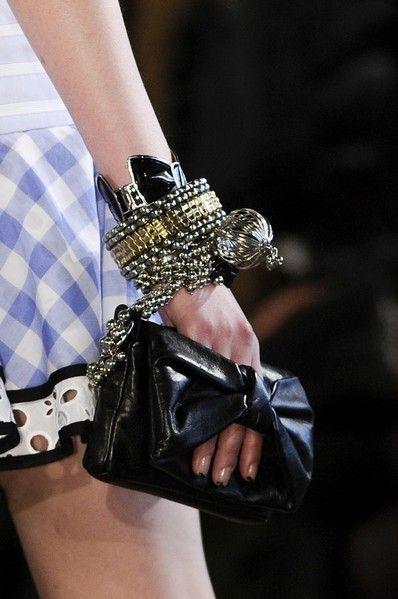 Wrist, Nail, Bracelet, Leather, Body jewelry, Plaid, Cosmetics, Costume accessory,