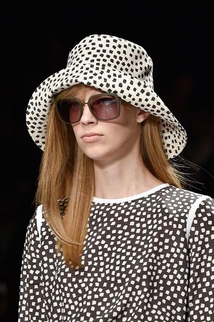 Clothing, Eyewear, Glasses, Nose, Vision care, Lip, Hat, Sleeve, Pattern, Sunglasses,