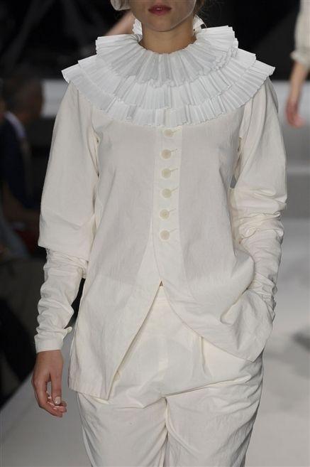Sleeve, Textile, Fashion, Costume design, Street fashion, Sunglasses, Fashion design, Costume, Fashion model, Embellishment,
