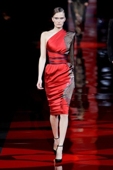 Dress, Fashion show, Shoulder, Red, Human leg, Joint, One-piece garment, Style, Fashion model, Runway,