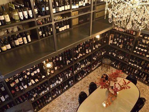 Table, Alcohol, Drinking establishment, Bottle, Shelf, Glass bottle, Barware, Alcoholic beverage, Drink, Distilled beverage,