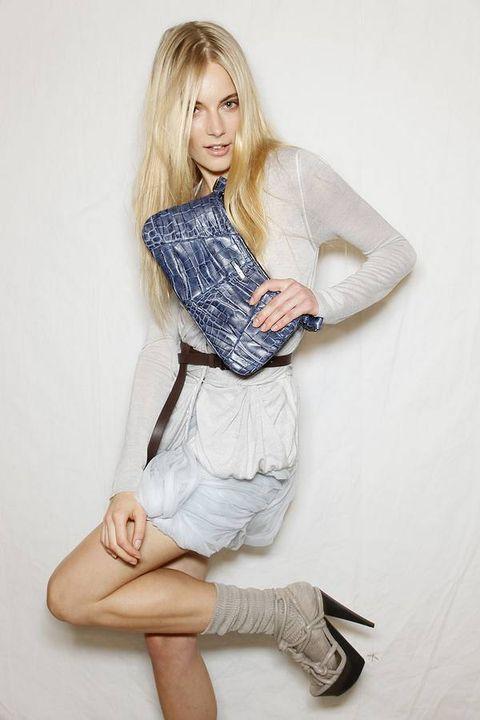 Clothing, Sleeve, Shoulder, Human leg, Textile, Joint, Denim, Style, Knee, Street fashion,