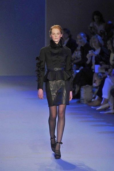 Fashion show, Event, Human body, Shoulder, Runway, Human leg, Joint, Outerwear, Style, Fashion model,