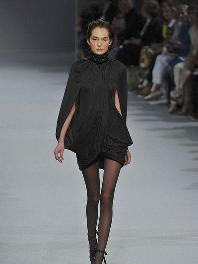 Clothing, Leg, Human, Fashion show, Human leg, Shoulder, Runway, Joint, Dress, Style,