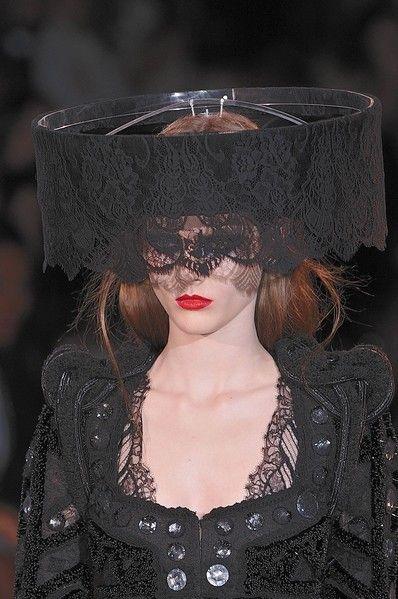 Lip, Headgear, Costume accessory, Fashion, Mannequin, Costume, Fashion design, Makeover, Embellishment, Day dress,