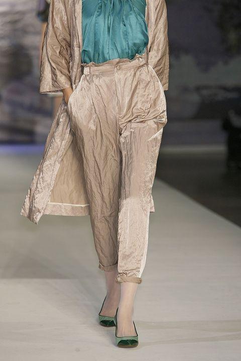 Textile, Human leg, Fashion, Foot, Beige, Sandal, Fashion model, Fashion design, Calf, Silk,